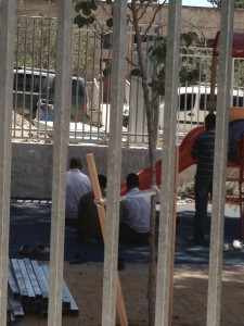 Muslim Construction Workers pray at the Kindergarten Construction site. Jerusalem, July 2014