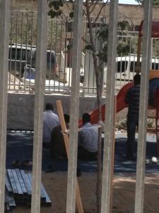 Muslim Construction Workers pray at the Kindergarten Construction site. Jerusalem, July 2014