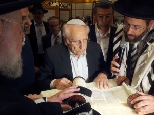 My father completing a Torah Scroll in memory of his father, Rabbi Moshe Chayim Lau